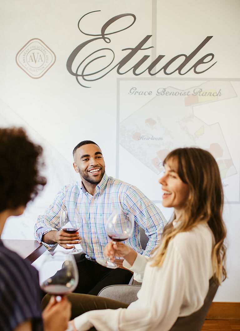 a group of people gathering at an Etude winery event
