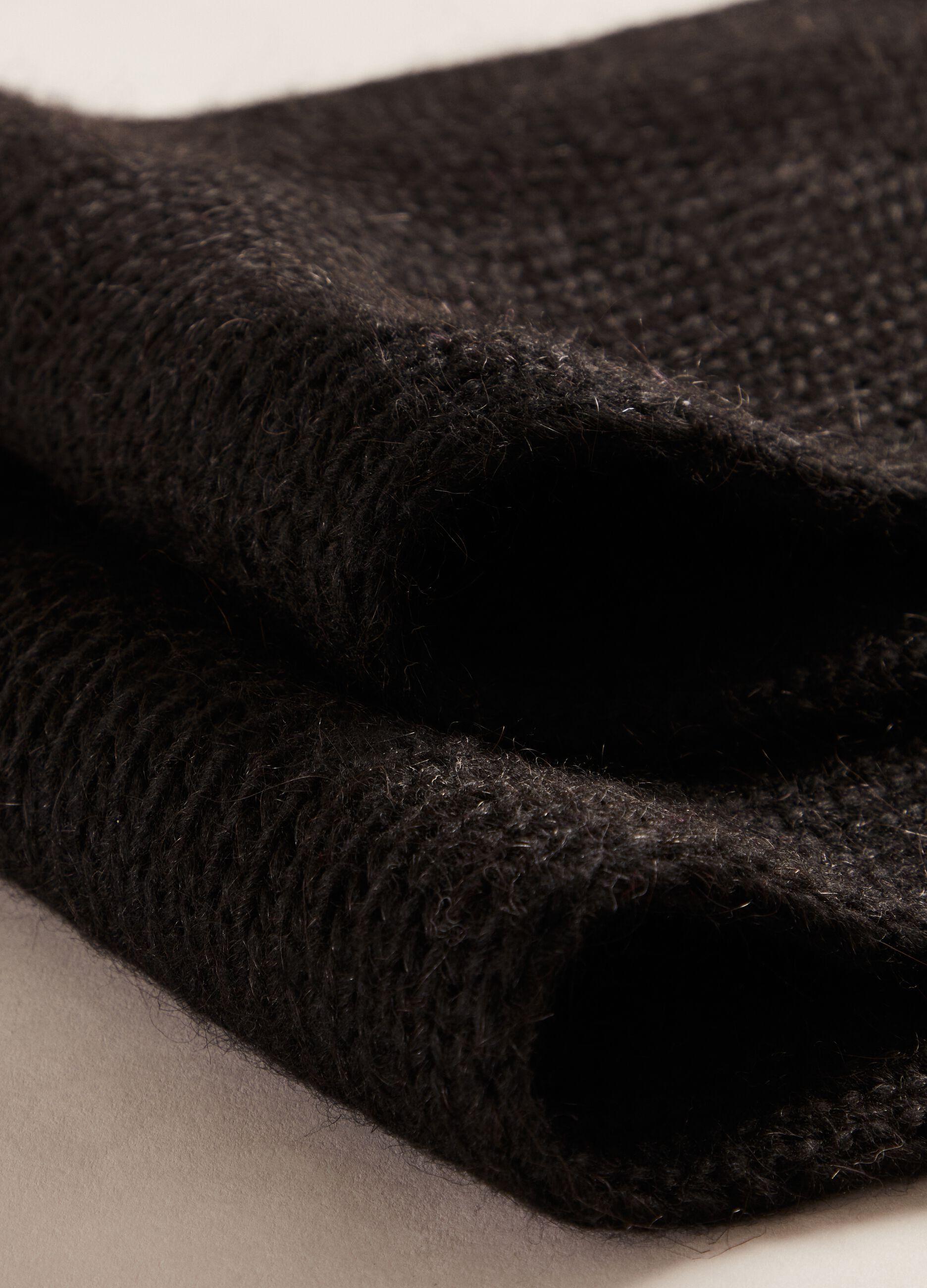 Maxi sciarpa con pon pon Nero